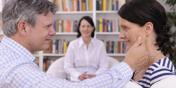 couple making up at therapy session with psychologist